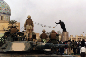 Toppling the statue of Saddam Hussein was a staged event, by U.S. soldiers, for the media. A Reuters long-shot of Firdos Square where the statue was located (see below) shows that the Square was nearly empty when Saddam was torn down. The Square was sealed off by the U.S. military. The 200 people milling about were U.S. Marines, international press and Iraqis. However, the media portrayed it as an event of the Iraqi people.
