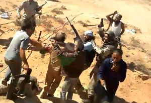 Daily Mail reports thatA Libyan revolutionary fighter has bragged in a leaked video that he was the man who killed Colonel Muammar Gaddafi, that country's despotic former ruler. The young man, who is pictured but has not yet been identified, said he killed the fallen dictator because he could not bear the thought of taking him alive.